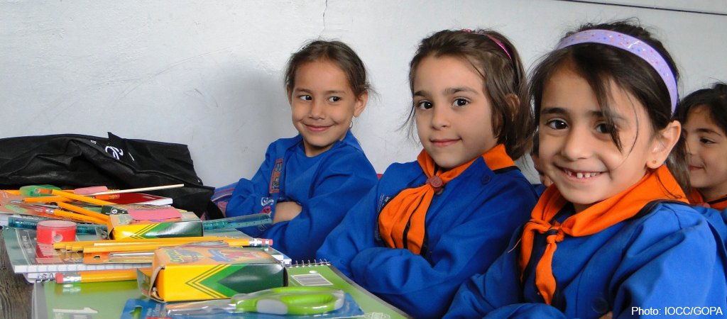 Young Syrian children with school kits.
