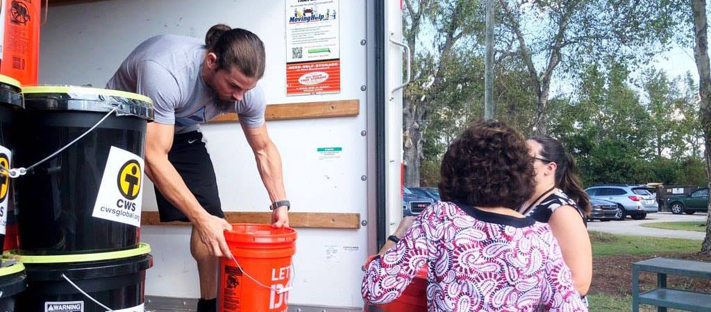 A CWS Emergency Cleanup Bucket boosts the morale of a recipient.